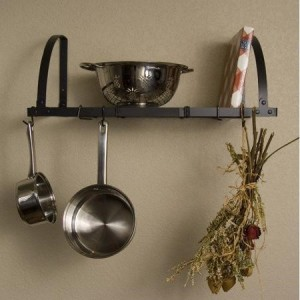 Hanging racks can help save cabinet space in small kitchens